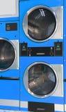 自动烘干机投入硬币后自动操作在洗衣店 免版税图库摄影