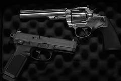 自卫或军事的两把手枪手枪 免版税库存图片