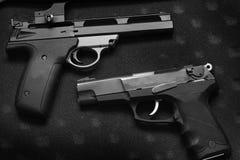 自卫或军事的两把手枪手枪 免版税库存照片