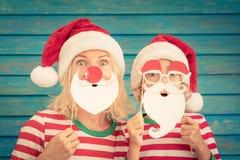 自圣诞前夕的愉快的家庭 库存照片