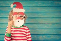 自圣诞前夕的滑稽的孩子 免版税库存图片