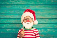自圣诞前夕的滑稽的孩子 免版税库存照片
