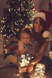 自圣诞前夕的闪烁发光物 免版税库存图片