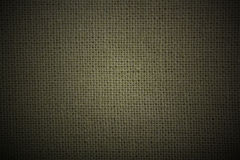 自然亚麻制绿色黑暗的物质背景 免版税库存图片
