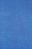 自然明亮的蓝色胡麻纤维亚麻制纹理,详细的宏指令 免版税库存图片