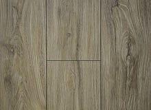 自然木头纹理  灰色背景,与结构和黑暗的细丝波浪  免版税库存照片