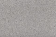 自然灰色被回收的纸纹理背景 免版税库存图片