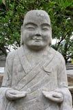 自然石头,中国菩萨雕象  免版税库存图片