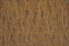 自然被编织的米黄织品 免版税图库摄影