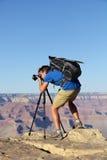 自然风景摄影师在大峡谷 免版税库存照片