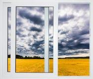 自然风景有看法通过与帷幕的窗口 免版税库存照片
