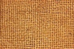 自然织地不很细粗麻布麻袋布黑森州的纹理咖啡大袋样式,黑暗的国家袋装的帆布,宏观背景 免版税库存照片