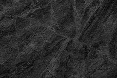 自然黑石墙背景或纹理背景 免版税库存照片