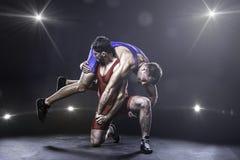 自由式摔跤手投掷 图库摄影
