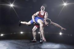 自由式摔跤手投掷 免版税图库摄影