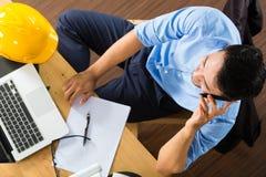 在家工作的建筑师 免版税库存照片