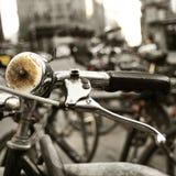 自行车在一个城市的街道锁了,有过滤器作用的 免版税库存照片