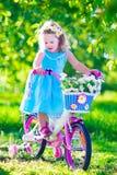 自行车女孩少许骑马 图库摄影