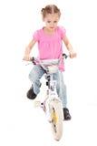 自行车女孩开玩笑骑马 免版税图库摄影