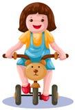 自行车女孩骑马 免版税库存图片