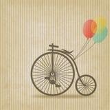 自行车有气球减速火箭的镶边背景 免版税图库摄影