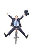 自行车生意人愉快的年轻人 免版税库存照片