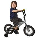 自行车男孩逗人喜爱的骑马 免版税库存图片