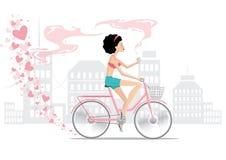 自行车的女孩在爱 库存照片