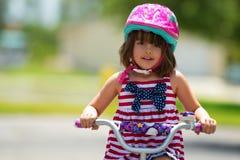 自行车的女孩 免版税图库摄影