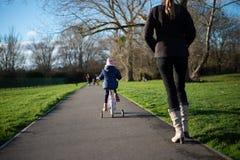 自行车的孩子在道路 免版税图库摄影