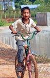 自行车的柬埔寨男孩 免版税图库摄影