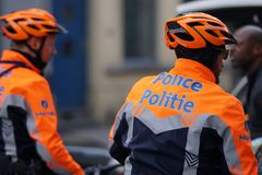 自行车的比利时警察 库存照片