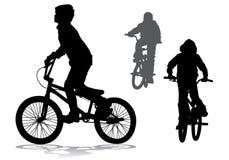 自行车的男孩 免版税库存图片