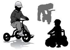 自行车的男孩 免版税图库摄影