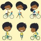自行车的非裔美国人的学校女孩 免版税库存图片