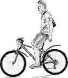 自行车的年轻人 库存照片