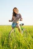 自行车领域女孩骑马 图库摄影