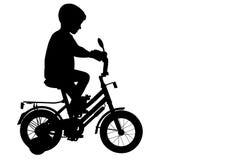 自行车骑士儿童裁减路线剪影 免版税库存图片