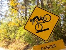 自行车骑士危险 免版税库存图片