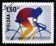 自行车骑士,致力于30国际性组织和平骑自行车的种族,华沙柏林布拉格,大约1977年 库存图片