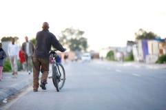 自行车黑人 库存图片