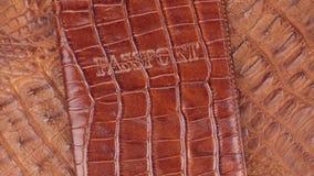 自转,特写镜头护照的褐色盖子,说谎在棕色鳄鱼皮肤 影视素材