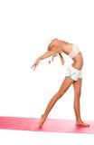 舒展女子瑜伽 免版税库存图片