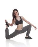 舒展年轻人的健身女孩 免版税库存照片