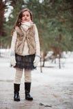 舒适温暖的室外冬天步行的儿童女孩 免版税库存照片