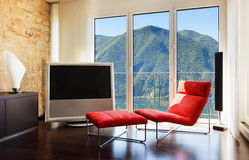 舒适的红色扶手椅子 图库摄影