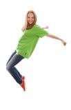 跳舞在白色的十几岁的女孩节律唱诵的音乐 免版税库存图片