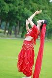 舞蹈亚裔中国肚皮舞表演者的亮光 库存图片