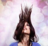 舞蹈和当事人概念-在行动的头发 免版税库存照片