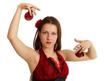 舞蹈女孩执行的西班牙年轻人 免版税库存图片